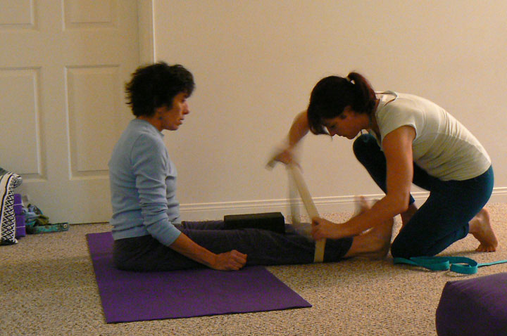 Nicole helps a student in aligning the knees.  This is good for the low back and hips!