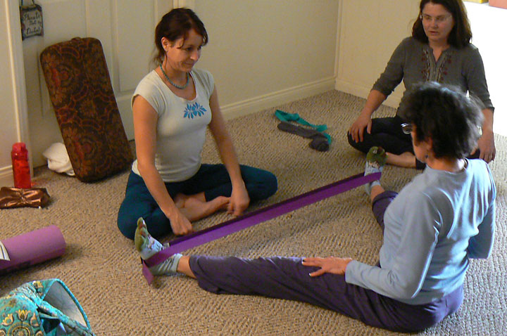 Nicole helps a student with those over-flexible hamstrings.